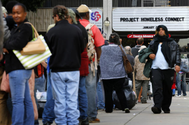 Homeless families and individuals line up to attend Project Homeless Connect in San Diego in 2015, a one-day resource fair. Local officials are trying to find ways to address an outbreak of hepatitis A. (Mike Blake / Reuters)