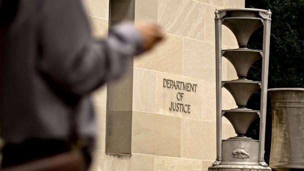 PHOTO: A pedestrians walks past the U.S. Department of Justice (DOJ) headquarters in Washington, D.C., Aug. 15, 2019.  (Andrew Harrer/Bloomberg via Getty Images)