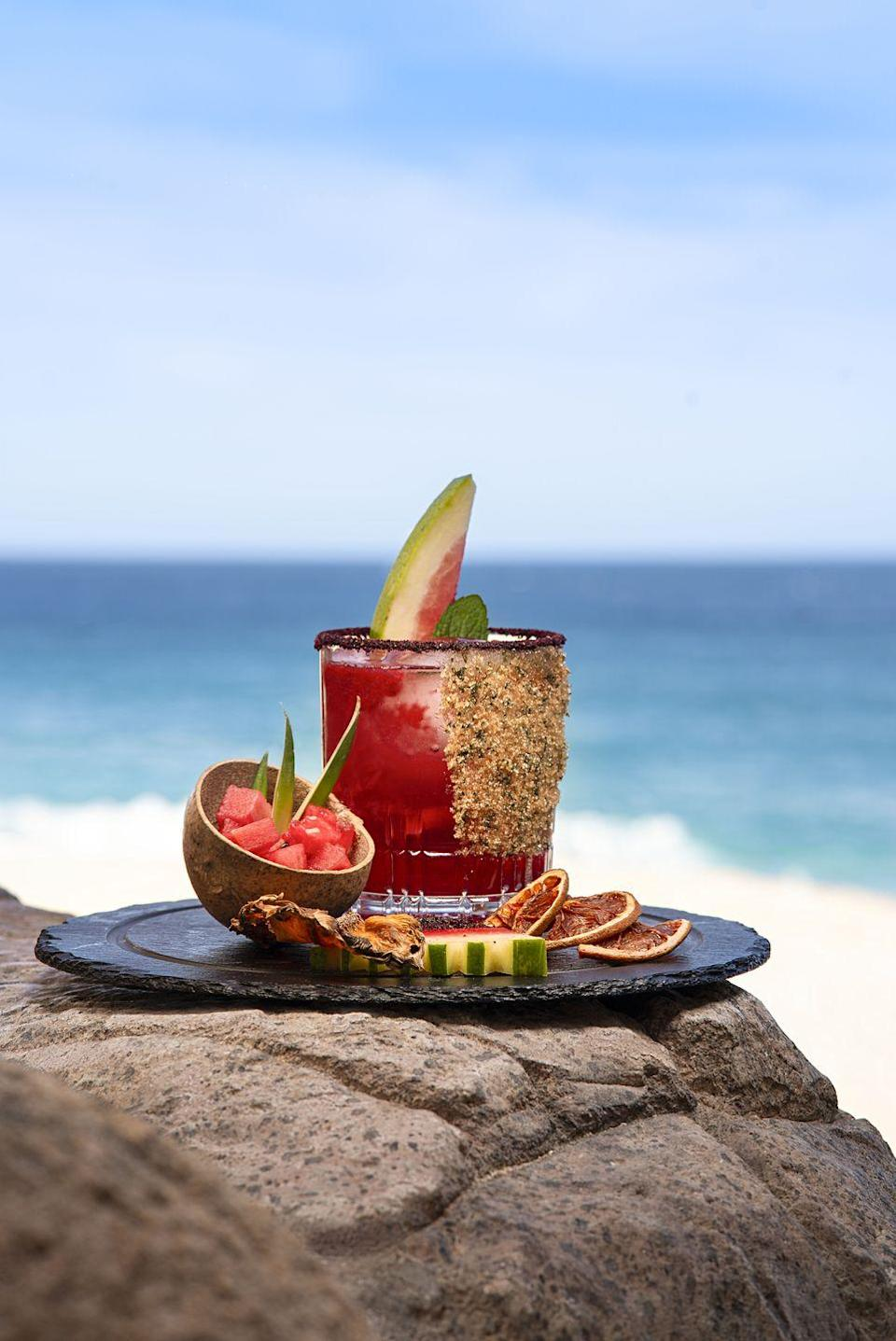 <p>This refreshing take on a classic margarita can be found at Grand Solmar Land's End Resort & Spa in Cabo San Lucas as part of this year's Margarita Festival hosted at the property. Luckily, they've showed us how to make it at home.</p><p><strong>Ingredients:</strong></p><p>2 ounces aged tequila (tequila añejo)</p><p>1 ounce watermelon puree</p><p>1 ounce pomegranate liqueur</p><p>1 1/2 ounces Triple Sec or Controyo</p><p>1 ounce lemon juice</p><p>1/2 ounce simple syurp,</p><p>basil leaves, for garnish</p><p><strong>Directions:</strong><br> Pour tequila, Triple Sec, pomegranate liqueur, and mashed watermelon into cocktail shaker and shake vigorously. Add lemon juice and simple syrup and shake again. Salt the rim of an Old-Fashioned glass and add ice. Pour in ingredients from cocktail shaker and garnish with a basil leaf.</p>