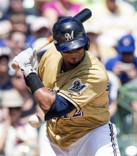 Milwaukee Brewers' Martin Maldonado is hit with a pitch by Philadelphia Phillies' Jonathan Pettibone during the second inning of a baseball game, Sunday, June 9, 2013, in Milwaukee. (AP Photo/Tom Lynn)