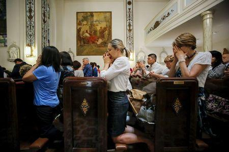 People pray while they attend the last mass at Church of Our Lady Peace in New York July 31, 2015. REUTERS/Eduardo Munoz