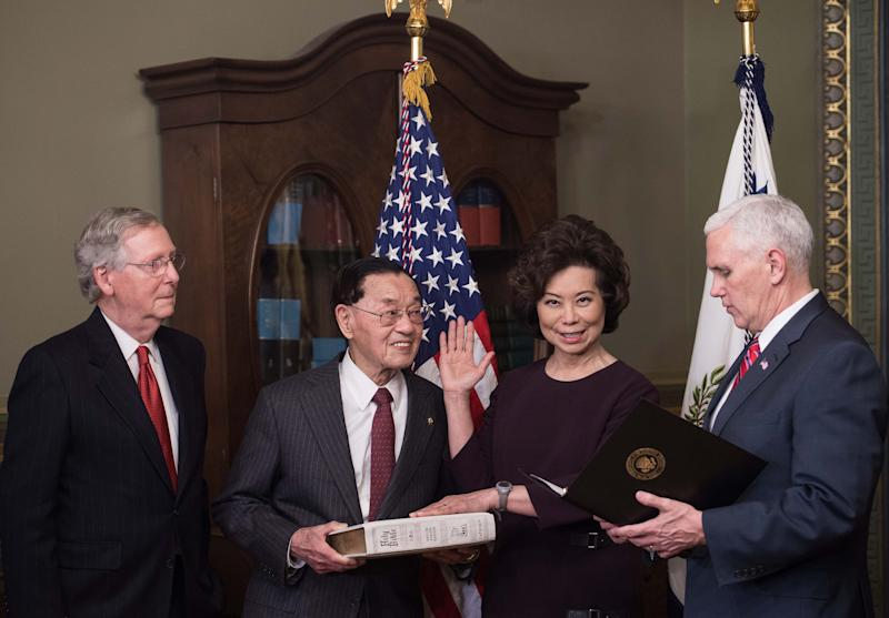 Elaine Chao (2R) is sworn in as US Transportation Secretary by Vice President Mike Pence (R) as her father James Chao (2L) and her husband Senate Majority Leader Mitch McConnell look on in Washington, DC, on January 31, 2017. (Photo: Nicholas Kamm/AFP/Getty Images)