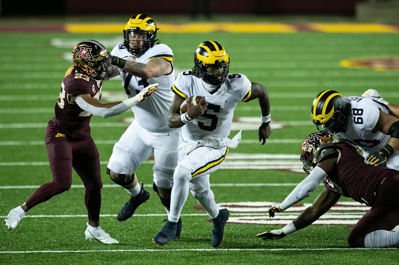 MINNEAPOLIS, MINNESOTA - OCTOBER 24: Joe Milton #5 of the Michigan Wolverines carries the ball against the Minnesota Golden Gophers in the second quarter of the game at TCF Bank Stadium on October 24, 2020 in Minneapolis, Minnesota. (Photo by David Berding/Getty Images)