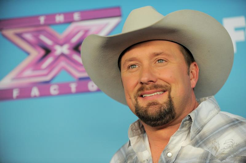 """Tate Stevens attends the """"The X Factor"""" season finale at CBS Television City on Thursday, Dec. 20, 2012, in Los Angeles. (Photo by Jordan Strauss/Invision/AP)"""