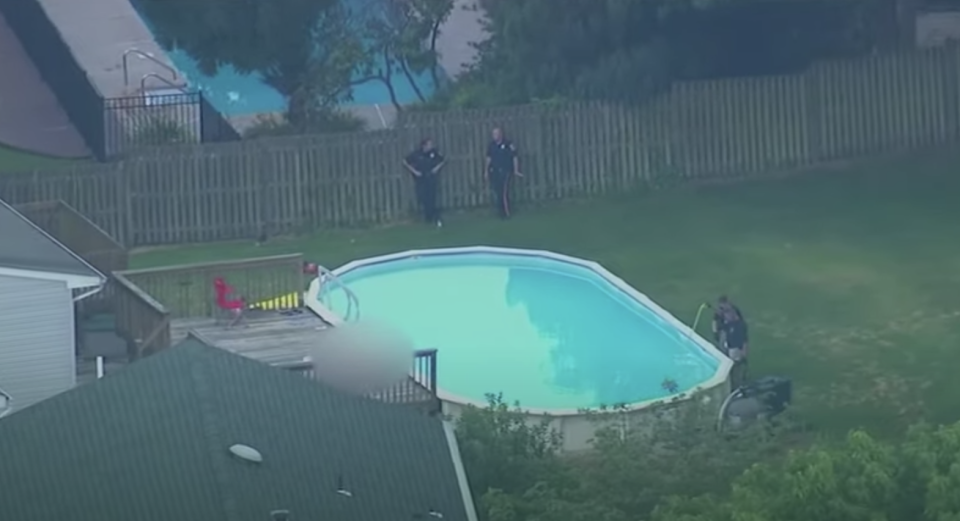 A swimming pool is pictured surrounded by police in New Jersey.