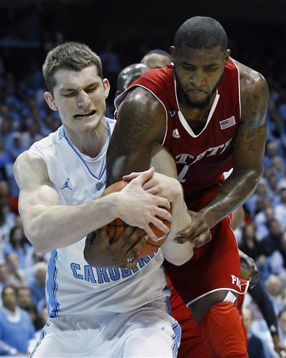 North Carolina's Tyler Zeller, left, and North Carolina State's Richard Howell struggle for possession of the ball during the first half of an NCAA college basketball game in Chapel Hill, N.C., Thursday, Jan. 26, 2012. (AP Photo/Gerry Broome)