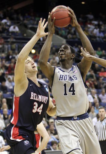Georgetown's Henry Sims, right, shoots over Belmont's Mick Hedgepeth during the second half of an NCAA college basketball tournament second-round game on Friday, March 16, 2012, in Columbus, Ohio. Georgetown defeated Belmont 74-59. (AP Photo/Jay LaPrete)