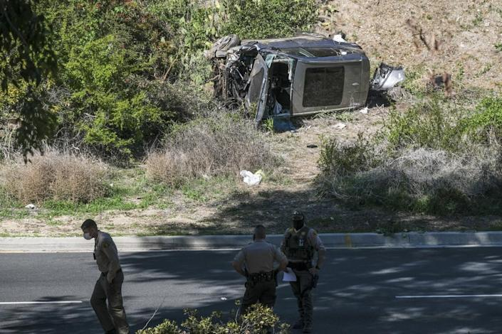 The SUV driven by Tiger Woods at the time of his crash in Rancho Palos Verdes on Tuesday morning rests on its side.