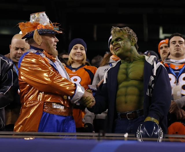 Fans shake hands before the NFL Super Bowl XLVIII football game between the Seattle Seahawks and the Denver Broncos Sunday, Feb. 2, 2014, in East Rutherford, N.J. (AP Photo/Evan Vucci)