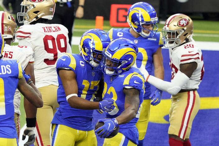 Los Angeles Rams running back Cam Akers (23) celebrates his rushing touchdown with Robert Woods (17) during the second half of an NFL football game against the San Francisco 49ers Sunday, Nov. 29, 2020, in Inglewood, Calif. (AP Photo/Alex Gallardo)
