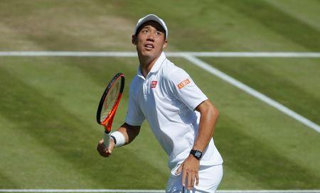 FILE PHOTO: Japan's Kei Nishikori in action during his third round match against Spain's Roberto Bautista Agut    REUTERS/Andrew Couldridge