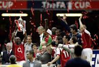 Arsenal captain Patrick Vieira lifts the FA Cup with his team-mates after defeating Manchester United. (Photo by Nick Potts - PA Images/PA Images via Getty Images)