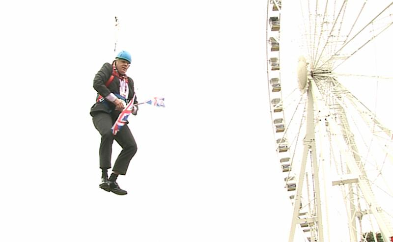 London Mayor Boris Johnson as he is left hanging in mid-air after he got stuck on a zipwire at an Olympic event at Victoria Park in the capital. (Photo by Ben Kendall/PA Images via Getty Images)
