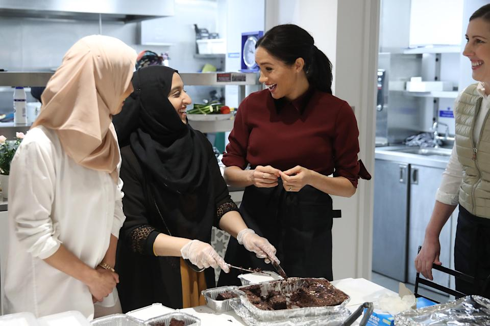 Meghan learned how proceeds from the cookbook has helped the community kitchen (Getty)