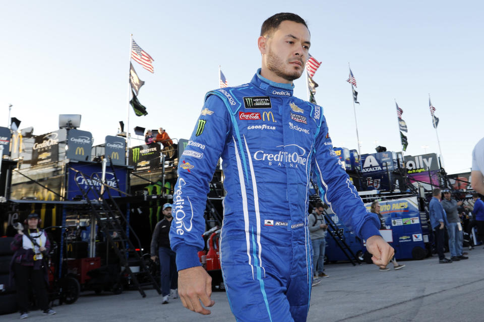 FILE - In this Oct. 18, 2019, file photo, Kyle Larson walks to the garage before the final practice for a NASCAR Cup Series auto race at Kansas Speedway in Kansas City, Kan. Kyle Larson was banished from NASCAR for all but the first month of his last season, his punishment for using a racial slur while racing online. Rick Hendrick felt the driver paid his penalty and deserved a second chance, one that begins with the season-opening Daytona 500. (AP Photo/Colin E. Braley, File)