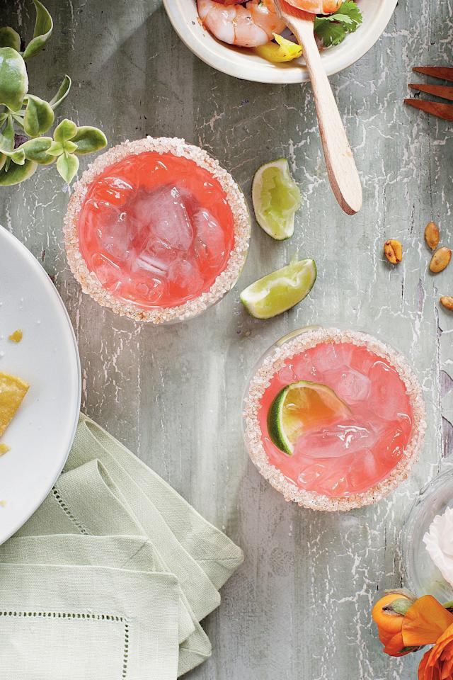 """<p><strong>Recipe:</strong> <a href=""""https://www.southernliving.com/syndication/pink-cadillac-margaritas""""><strong>Pink Cadillac Margaritas</strong></a></p> <p>Fast Flourish: Rub rims of chilled glasses with a lime wedge, dip in a saucer of coarse salt and sparkling sugar, and twirl to coat.</p>"""