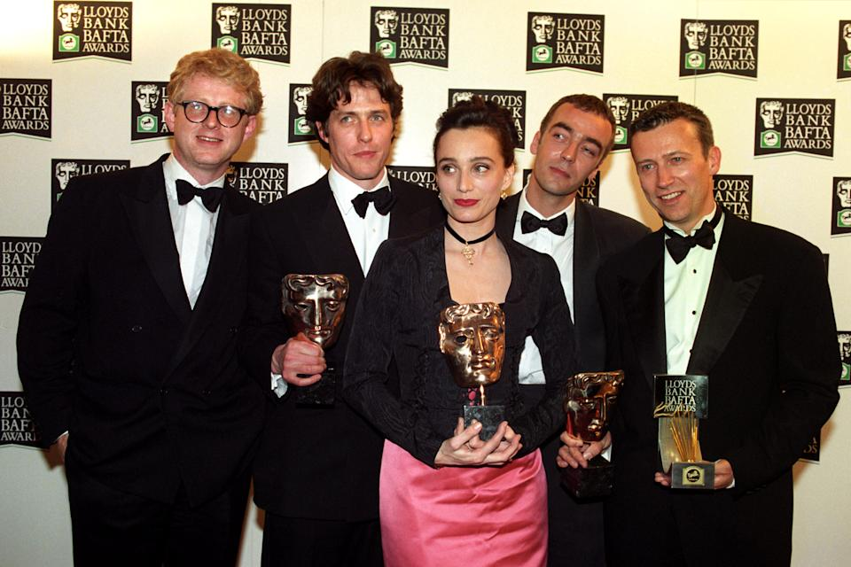 BAFTA AWARDS CEREMONY AT THE LONDON PALLADIUM. HUGH GRANT WHOSE MOVIE FOUR WEDDINGS AND A FUNERAL SCOOPED THE BOARD WITH FIVE AWARDS. IN LINE UP- (L-R) RICHARD CURTIS, HUGH GRANT, KRISTIN SCOT-THOMAS, JOHN HANNAH AND DUNCAN KENWORTHY.   (Photo by Sean Dempsey - PA Images/PA Images via Getty Images)