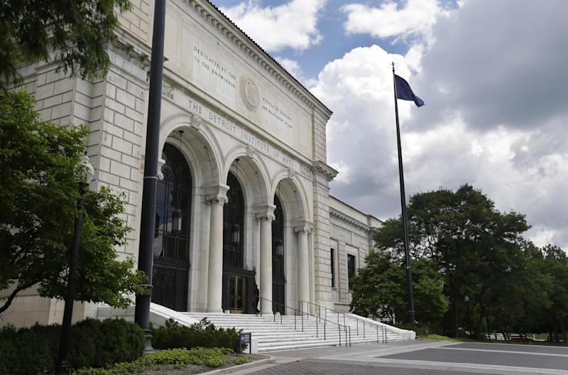 HOLD FOR STORY BY COREY WILLIAMS- In a June 13, 2013 photo, the front entrance to the Detroit Institute of Arts in Detroit is seen. In a quest to balance the budget in cash-strapped Detroit, the city's emergency manager is proposing a controverial idea: sell the city's art. T (AP Photo/Carlos Osorio)