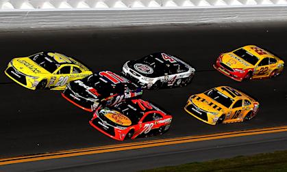 DAYTONA BEACH, FL - FEBRUARY 21: Matt Kenseth, driver of the #20 Dollar General Toyota, races Denny Hamlin, driver of the #11 FedEx Express Toyota, and Martin Truex Jr., driver of the #78 Bass Pro Shops/Tracker Boats Toyota, ahead of the field during the NASCAR Sprint Cup Series DAYTONA 500 at Daytona International Speedway on February 21, 2016 in Daytona Beach, Florida. (Photo by Sean Gardner/Getty Images) | Getty Images