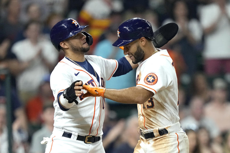 Houston Astros' Abraham Toro (13) celebrates with Yuli Gurriel after both scored on Toro's home run against the Chicago White Sox during the seventh inning of a baseball game Thursday, June 17, 2021, in Houston. (AP Photo/David J. Phillip)
