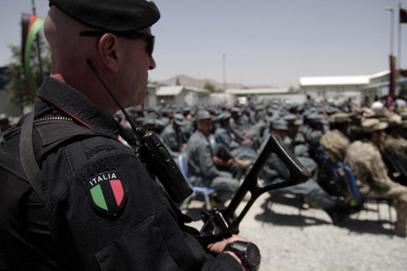 An Italian Soldier stands during a transfer of authority ceremony of the police academy from NATO-led troops to Afghan security forces in Kabul, Afghanistan, Saturday, June 22, 2013. (AP Photo/Rahmat Gul)