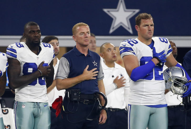 (From left) Former Cowboys wide receiver Dez Bryant, former head coach Jason Garrett and former tight end Jason Witten (82) stand during the national anthem. (AP Photo/Michael Ainsworth)