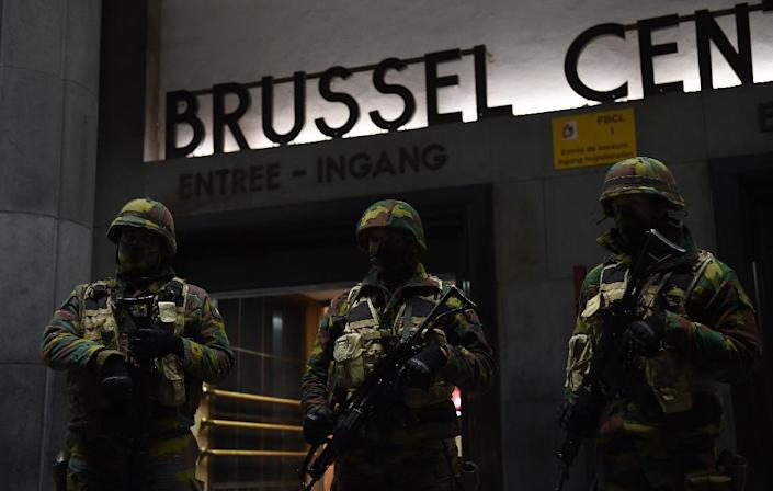 Soldiers stand guard in front of the central train station on November 22, 2015 in Brussels (AFP Photo/Emmanuel Dunand)