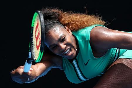 Serena Williams comfortably beats Bouchard to move into third round