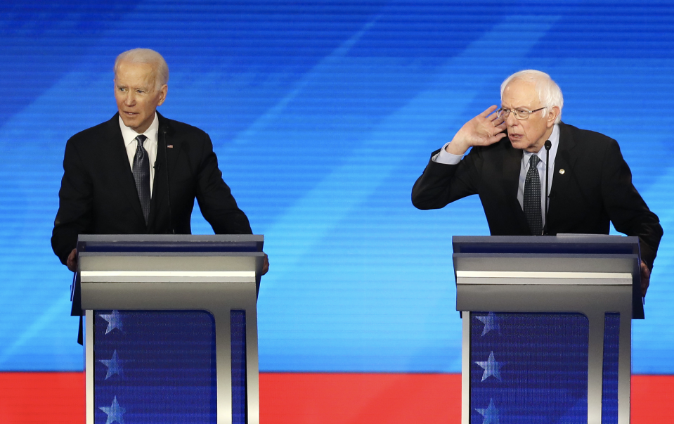 Democratic presidential candidates former Vice President Joe Biden and Sen. Bernie Sanders (I-VT) at the Democratic presidential primary debate in the Sullivan Arena at St. Anselm College on February 07, 2020 in Manchester, New Hampshire. (Photo: Joe Raedle/Getty Images)