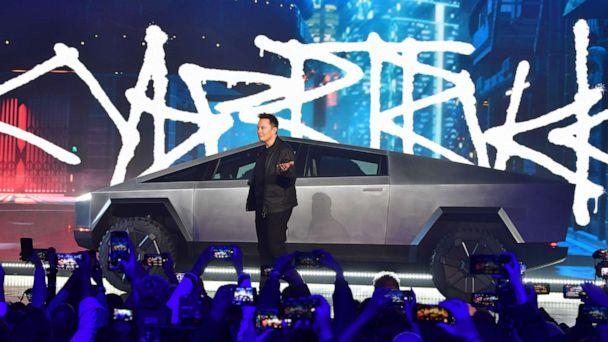 PHOTO: Tesla co-founder and CEO Elon Musk unveils the all-electric battery-powered Tesla's Cybertruck at Tesla Design Center in Hawthorne, Calif., on Nov. 21, 2019. (Frederic J. Brown/AFP via Getty Images)