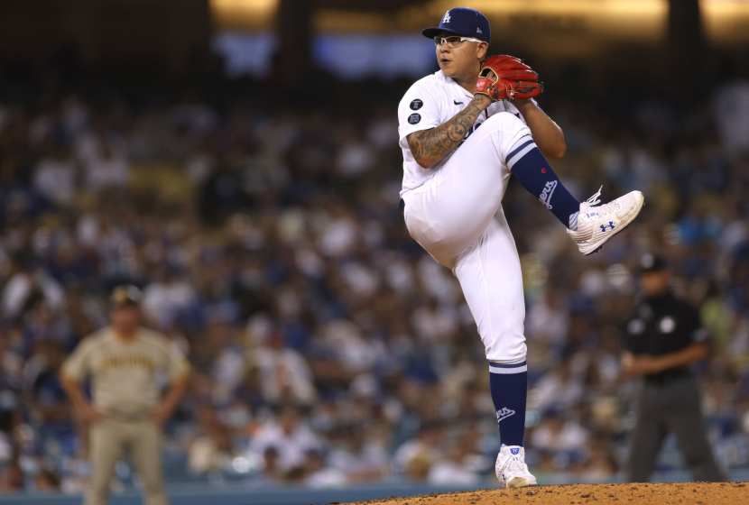 Julio Urias #7 of the Los Angeles Dodgers pitches against the San Diego Padres during the seventh inning.