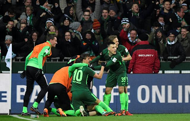 Soccer Football - Bundesliga - Werder Bremen vs Hamburger SV - Weser-Stadion, Bremen, Germany - February 24, 2018 Werder Bremen players celebrate their first goal REUTERS/Fabian Bimmer DFL RULES TO LIMIT THE ONLINE USAGE DURING MATCH TIME TO 15 PICTURES PER GAME. IMAGE SEQUENCES TO SIMULATE VIDEO IS NOT ALLOWED AT ANY TIME. FOR FURTHER QUERIES PLEASE CONTACT DFL DIRECTLY AT + 49 69 650050