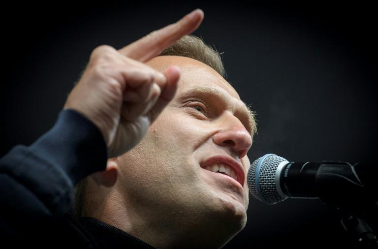 Russian opposition leader Alexei Navalny said he was questioned by investigators as part of a new probe into suspected slander over comments he made on social media  (AFP Photo/Yuri KADOBNOV)