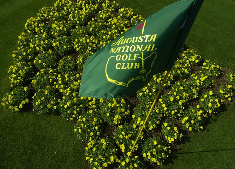 FILE - This April 7, 2002 file photo shows The Augusta National Golf Club flag framed by yellow flowers planted in the shape of the United States on display in front of the clubhouse in Augusta, Ga. For the first time in it's 80-year history, Augusta National Golf Club has female members. The home of the Masters, under increasing criticism the last decade because of its all-male membership, invited former Secretary of State Condoleeza Rice and South Carolina financier Darla Moore to become the first women in green jackets when the club opens for a new season in October. (AP Photo/Dave Martin, FIle)