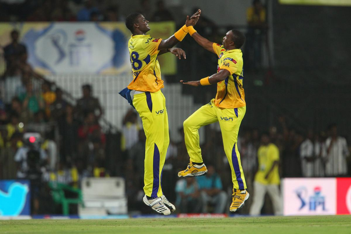 Jason Holder and Dwayne Bravo celebrate the wicket of  Ashish Nehra during match 64 of the Pepsi Indian Premier League between The Chennai Superkings and the Delhi Daredevils held at the MA Chidambaram Stadium in Chennai on the 14th May 2013..Photo by Ron Gaunt-IPL-SPORTZPICS   .. .Use of this image is subject to the terms and conditions as outlined by the BCCI. These terms can be found by following this link:..https://ec.yimg.com/ec?url=http%3a%2f%2fwww.sportzpics.co.za%2fimage%2fI0000SoRagM2cIEc&t=1506204617&sig=vkwhvVpoChOa.0beEkMH0A--~D