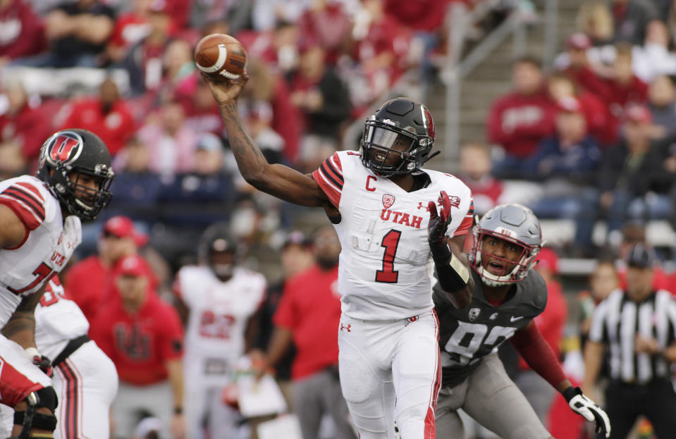 FILE - In this Sept. 29, 2018, file photo, Utah quarterback Tyler Huntley (1) throws a pass in front of Washington State defensive end Will Rodgers III (92) during the second half of an NCAA college football game in Pullman, Wash. Utah, which plays Stanford this week, is averaging just 16 points per game against FBC competition as Huntley hasn't thrown a TD pass since a season-opening win against FCS-level Weber State. (AP Photo/Young Kwak, File)