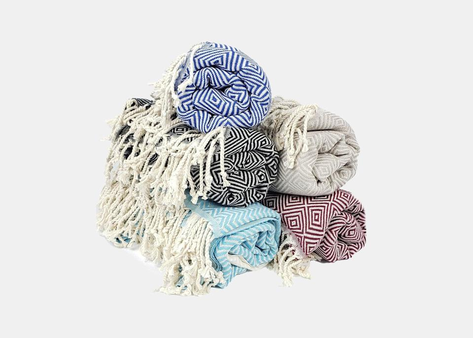 """All beach towels are not created equal. Courtney Blacher, single mom to 12-year-old Reese and creator of the <a href=""""https://www.worldinfourdays.com/"""" rel=""""nofollow noopener"""" target=""""_blank"""" data-ylk=""""slk:World In Four Days"""" class=""""link rapid-noclick-resp"""">World In Four Days</a> blog, loves Fly Apparel's Turkish beach towels; made with 100 percent pure organic Turkish cotton, they're environmentally friendly and super soft, she says. Plus, their sophisticated designs don't scream beach, allowing them to double as throws for the plane ride. """"When Reese and I visited the <a href=""""https://www.cntraveler.com/gallery/best-resorts-in-the-bahamas-bermuda-turks-and-caicos?mbid=synd_yahoo_rss"""" rel=""""nofollow noopener"""" target=""""_blank"""" data-ylk=""""slk:Bahamas"""" class=""""link rapid-noclick-resp"""">Bahamas</a> last year, we packed one for each of us in our <a href=""""https://www.cntraveler.com/gallery/the-best-carry-on-luggage?mbid=synd_yahoo_rss"""" rel=""""nofollow noopener"""" target=""""_blank"""" data-ylk=""""slk:carry-on"""" class=""""link rapid-noclick-resp"""">carry-on</a>,"""" she says. """"They kept us warm on the airplane and stylish on the beach."""" $85, Fly Apparel. <a href=""""https://shopflyapparel.com/products/100-pure-organic-turkish-cotton-beach-towel-throw"""" rel=""""nofollow noopener"""" target=""""_blank"""" data-ylk=""""slk:Get it now!"""" class=""""link rapid-noclick-resp"""">Get it now!</a>"""