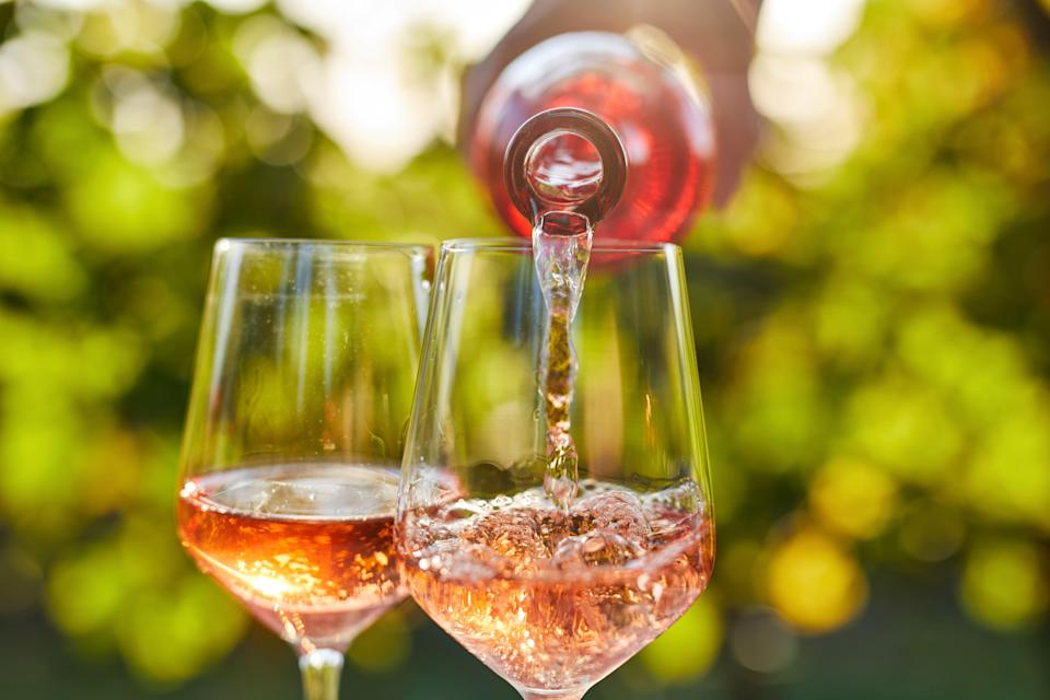 """<p>While there aren't any hard-and-fast rules about what varietals you can drink when, in recent years rosé wine has undoubtedly become the official drink of summer. There's just something about the light, bright wine that's just right for lounging poolside. Plus, it pairs perfectly with summer <a href=""""https://www.oprahdaily.com/life/g27062048/cookout-food-menu/"""" rel=""""nofollow noopener"""" target=""""_blank"""" data-ylk=""""slk:cookout fare"""" class=""""link rapid-noclick-resp"""">cookout fare</a> like fish and caprese salad. Not to mention, the subtle pink hue just screams summertime fun. </p><p>But if you're scanning store shelves at your local wine shop, Target, or Trader Joes, how do you know what rosés are worth your time—and which ones are better left right where they are? There are three appellations that are strictly for rosé wines, says <a href=""""https://tryhungry.com/virtual-events"""" rel=""""nofollow noopener"""" target=""""_blank"""" data-ylk=""""slk:Erik Segelbaum"""" class=""""link rapid-noclick-resp"""">Erik Segelbaum</a>, <a href=""""https://tryhungry.com/virtual-events"""" rel=""""nofollow noopener"""" target=""""_blank"""" data-ylk=""""slk:HUNGRY's Sommelier"""" class=""""link rapid-noclick-resp"""">HUNGRY's Sommelier</a>: Tavel in the Rhône Valley, Rosé de Riceys in the Champagne region of France, and Cerasuolo d'Abruzzo in Italy. In these areas—and in a few other select locales, like Provence—the grapes are harvested with the explicit mindset of making rosé wine, says <a href=""""https://www.instagram.com/cheroncowan/?hl=en"""" rel=""""nofollow noopener"""" target=""""_blank"""" data-ylk=""""slk:Cheron Cowan"""" class=""""link rapid-noclick-resp"""">Cheron Cowan</a>, beverage director at Maialino Mare. Because of that, bottles from these regions tend to be a good bet. (In many other places, rosé tends to be an afterthought, he explains.) </p><p>That's not to say there aren't plenty of other quality rosés from around the world, though. Whether you prefer dry or sweet, there are great bottles coming from Oregon, New Zealand, Spain, and a variety of oth"""