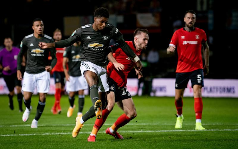 Marcus Rashford of Manchester United scores his teams second goal during the Carabao Cup Third Round match between Luton Town and Manchester United at Kenilworth Road - GETTY IMAGES
