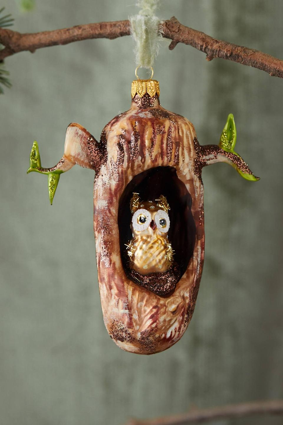 """<p>Mimic the <a href=""""https://www.popsugar.com/buy/Owl-Tree-Glass-Ornament-502212?p_name=Owl%20in%20a%20Tree%20Glass%20Ornament&retailer=anthropologie.com&pid=502212&price=48&evar1=casa%3Aus&evar9=46615300&evar98=https%3A%2F%2Fwww.popsugar.com%2Fhome%2Fphoto-gallery%2F46615300%2Fimage%2F46767570%2FOwl-in-Tree-Glass-Ornament&list1=shopping%2Canthropologie%2Choliday%2Cchristmas%2Cchristmas%20decorations%2Choliday%20decor%2Chome%20shopping&prop13=mobile&pdata=1"""" rel=""""nofollow noopener"""" class=""""link rapid-noclick-resp"""" target=""""_blank"""" data-ylk=""""slk:Owl in a Tree Glass Ornament"""">Owl in a Tree Glass Ornament</a> ($48) by hanging it in your own tree; it'll look so cute.</p>"""