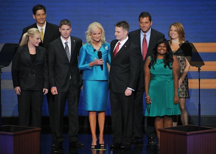 Cindy McCain, wife of Republican presidential nominee, stands on stage with family members during the Republican National Convention 2008 at the Xcel Energy Center in St. Paul, Minnesota, on September 04, 2008. From L-R: Andrew, Meghan, Jimmy, Cindy, Jack, Doug, Bridget and Sydney. AFP PHOTO Paul J. RICHARDS (Photo credit should read PAUL J. RICHARDS/AFP/Getty Images)