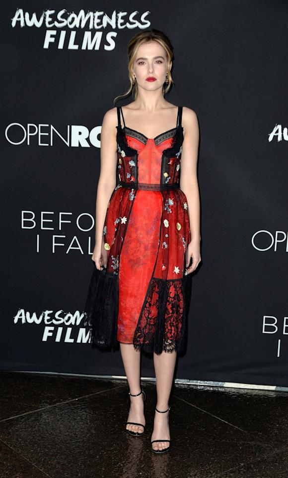 <p>Deutch arrived for the <strong>Before I Fall</strong> LA premiere in a daring red-and-black Alexander McQueen floral lace dress and strappy black heels. </p>
