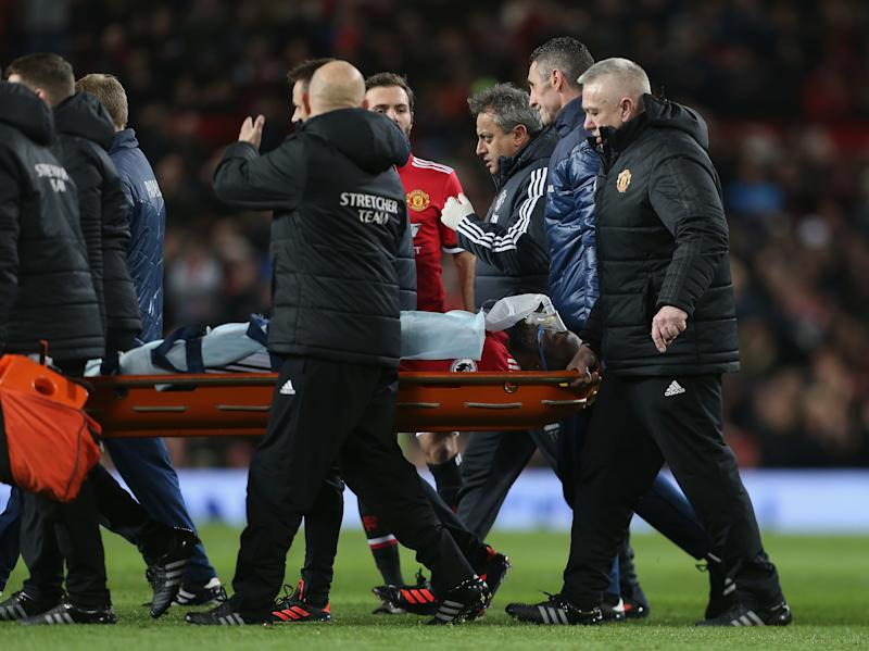 Romelu Lukaku carried off with apparent head injury