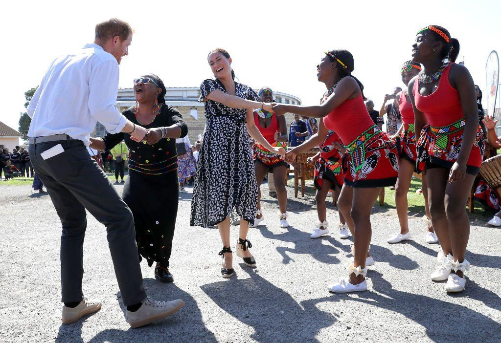 <p>Both Harry and Meghan joined in the dancing as they visited a Justice Desk initiative in the Nyanga township, during their royal tour of South Africa.</p>