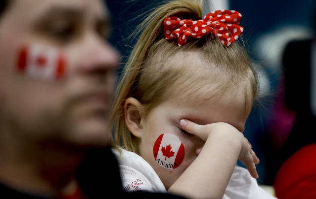 <p>A Canadian fan covers her eyes during the Men's Curling Match for the bronze medal between Canada and Switzerland at the PyeongChang 2018 Winter Olympics in South Korea, Feb. 23, 2018.<br> (AP Photo/Natacha Pisarenko) </p>
