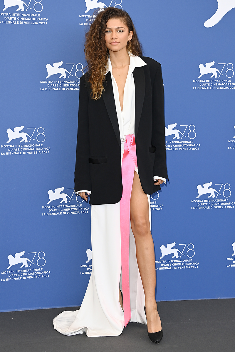 """<p>The day before, she wore this <a href=""""https://www.cosmopolitan.com/uk/fashion/celebrity/g37488296/venice-international-film-festival-2021-celebrity-fashion/?slide=11"""" rel=""""nofollow noopener"""" target=""""_blank"""" data-ylk=""""slk:suit-turned-dress"""" class=""""link rapid-noclick-resp"""">suit-turned-dress</a> situation by Valentino Haute Couture.</p>"""
