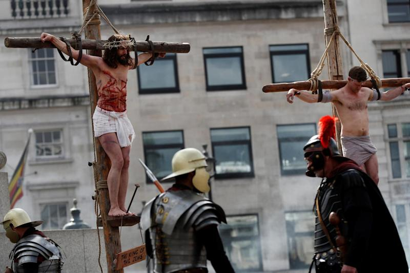 Jesus hangs from the cross in the performance of The Passion of Jesus in Trafalgar Square (Reuters)
