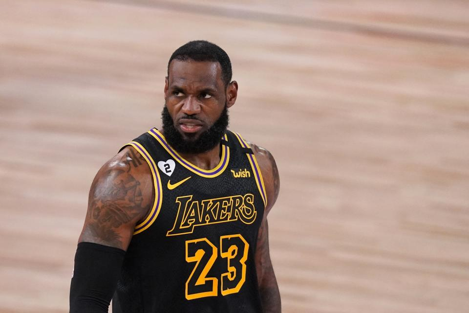 Los Angeles Lakers' LeBron James walks up court during the first half of Game 2 of basketball's NBA Finals against the Miami Heat on Friday, Oct. 2, 2020, in Lake Buena Vista, Fla. (AP Photo/Mark J. Terrill)