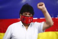 Former Bolivian President Evo Morales raises his fist as he arrives for a press conference at Movement Towards Socialism (MAS) headquarters in Buenos Aires, Argentina, during general elections in his home country, Sunday, Oct. 18. 2020. (AP Photo/Marcos Brindicci)