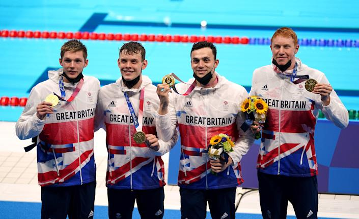 Duncan Scott, Tom Dean, Matthew Richards and James Guy with their 4x200m freestyle medals (Joe Giddens/PA) (PA Wire)